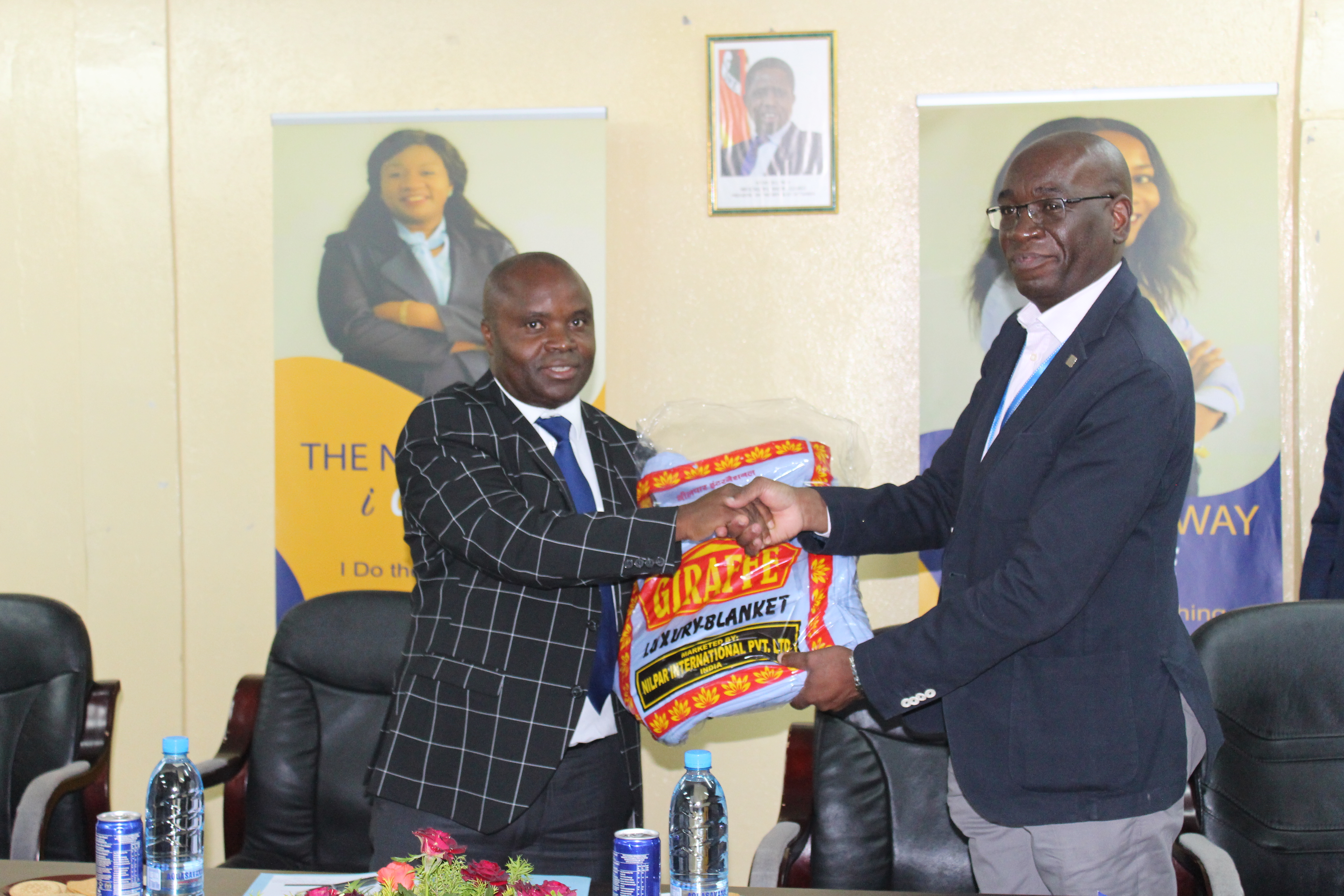 NAPSA Director General Mr. Yollard Kachinda handing over donated linen to UTH Adult Hospital as part  of the Authority's Corporate Social Responsibility.