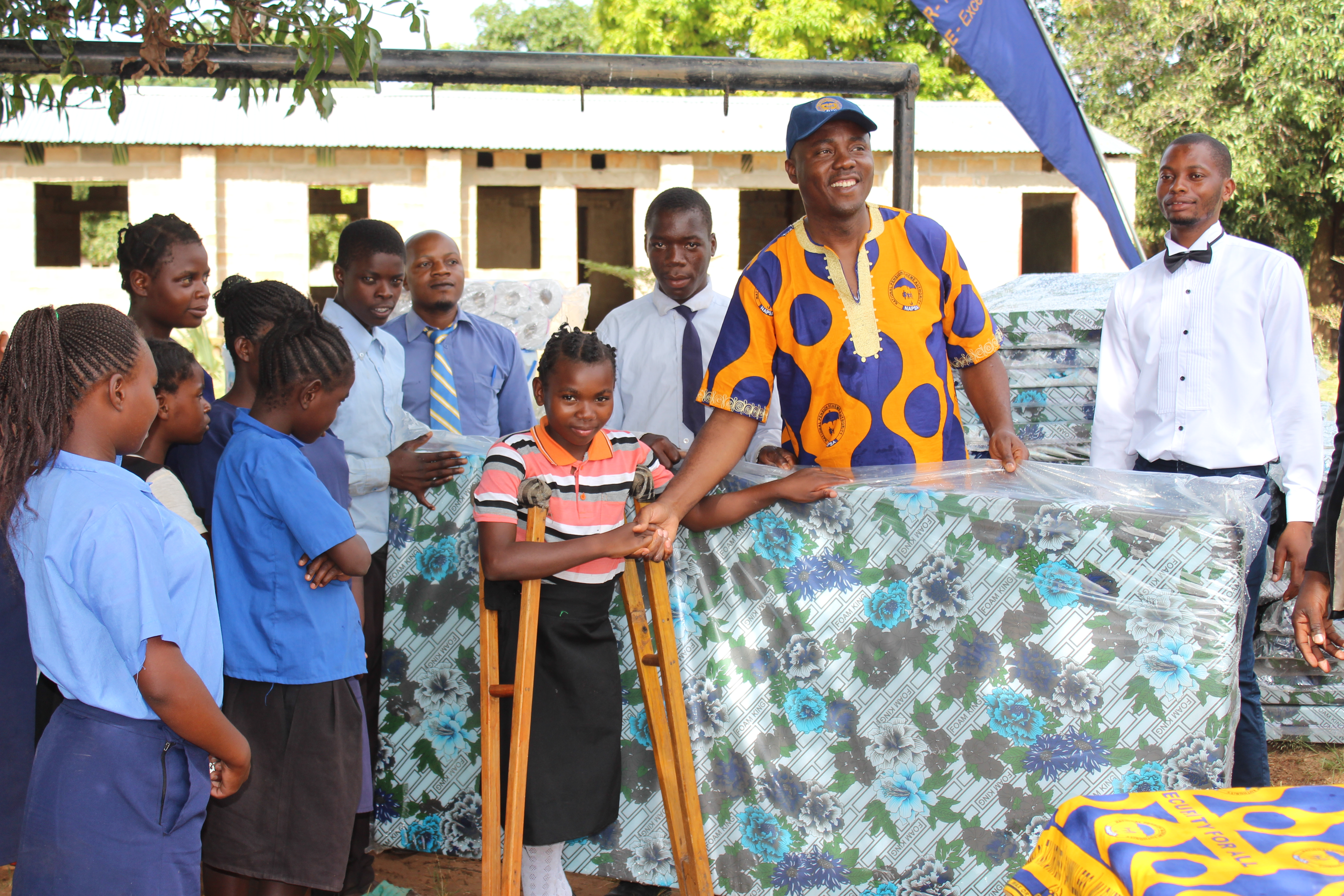 NAPSA Regional Manager North Mr. Mushoke Namiluko donating assorted items to Chinsali Primary School pupils with special needs to help enhance their learning environment.